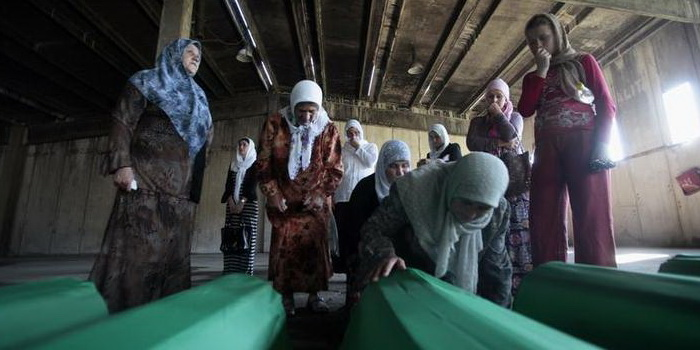 Bosnian Muslim women cry near coffins in Potocari, near Srebrenica, July 9, 2011. The bodies of the 614 recently identified victims of Srebrenica massacre will be buried on July 11, the anniversary of the massacre when Bosnian Serb forces slaughtered 8,000 Muslim men and boys and buried them in mass graves in Europe's worst massacre since World War Two.  REUTERS/Dado Ruvic (BOSNIA AND HERZEGOVINA - Tags: ANNIVERSARY POLITICS OBITUARY CONFLICT)